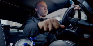 Vin Diesel as Dominic Toretto driving a car in F9
