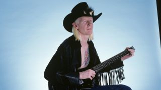 Johnny Winter playing a headless guitar