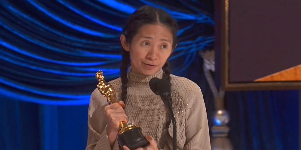 Eternals director Chloé Zhao accepts her Best Director award at the Oscars