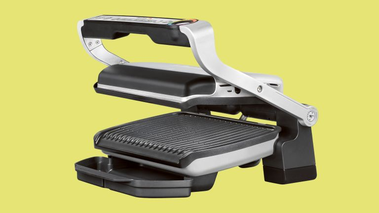 Tefal OptiGrill+ review: the machine on a green background
