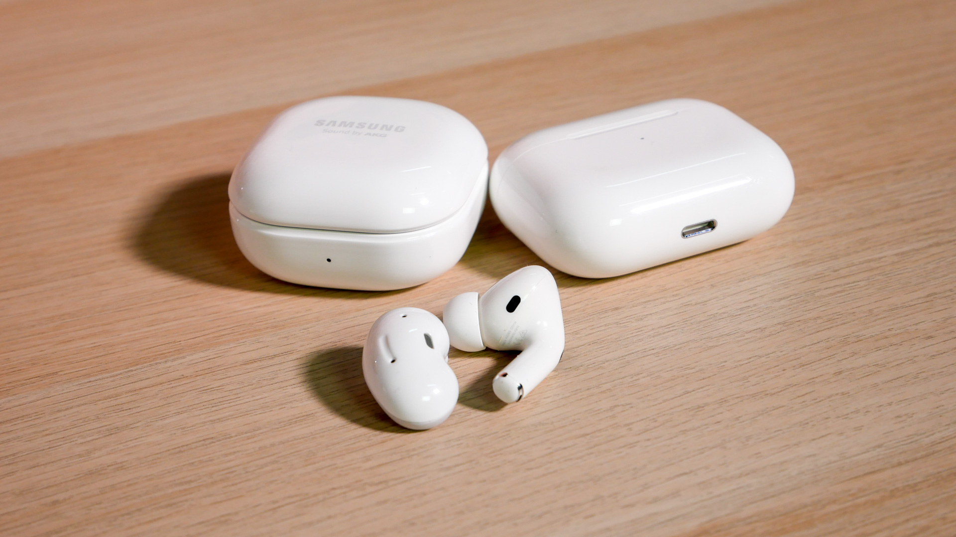 The Samsung Galaxy Buds Live (left) with the AirPods Pro