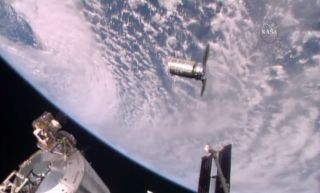 A robotic Orbital ATK Cygnus cargo ship arrives at the International Space Station on Oct. 23, 2016 to deliver 5,100 lbs. of supplies and science gear to the outpost's six-person crew.