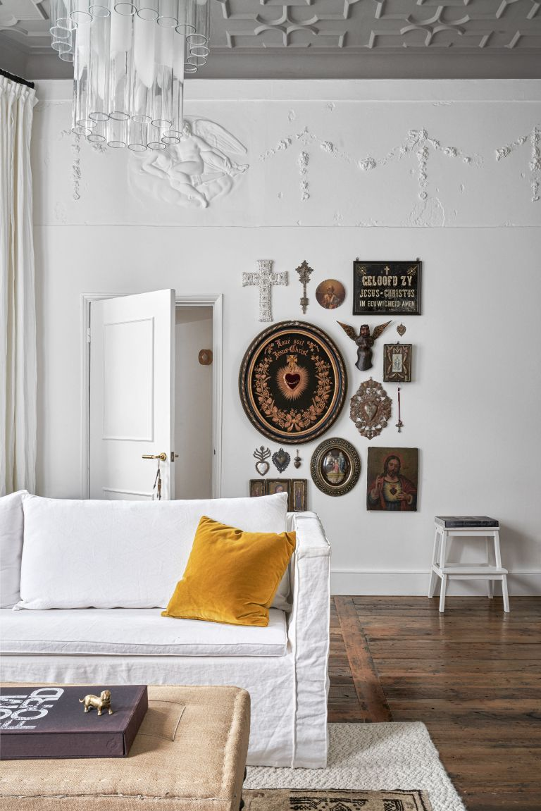 Rustic white living room with white sofa and gallery wall