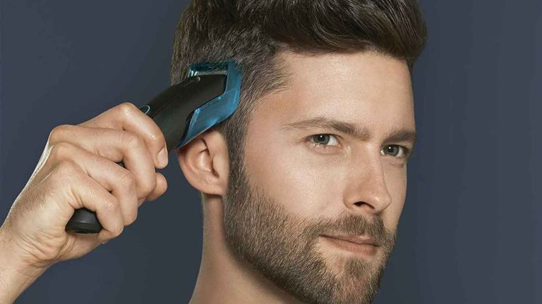 best hair clippers: Braun HC5010 Hair Clipper in use on man