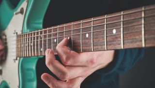 A guitarist tears up the fretboard