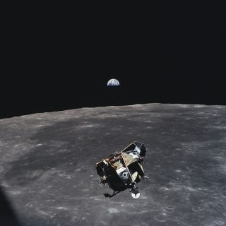 The Apollo 11 lunar landing module Eagle, with astronauts Neil Armstrong and Buzz Aldrin aboard, is photographed above the moon by crewmate Michael Collins on the Columbia command module during rendezvous operations on July 21, 1969.