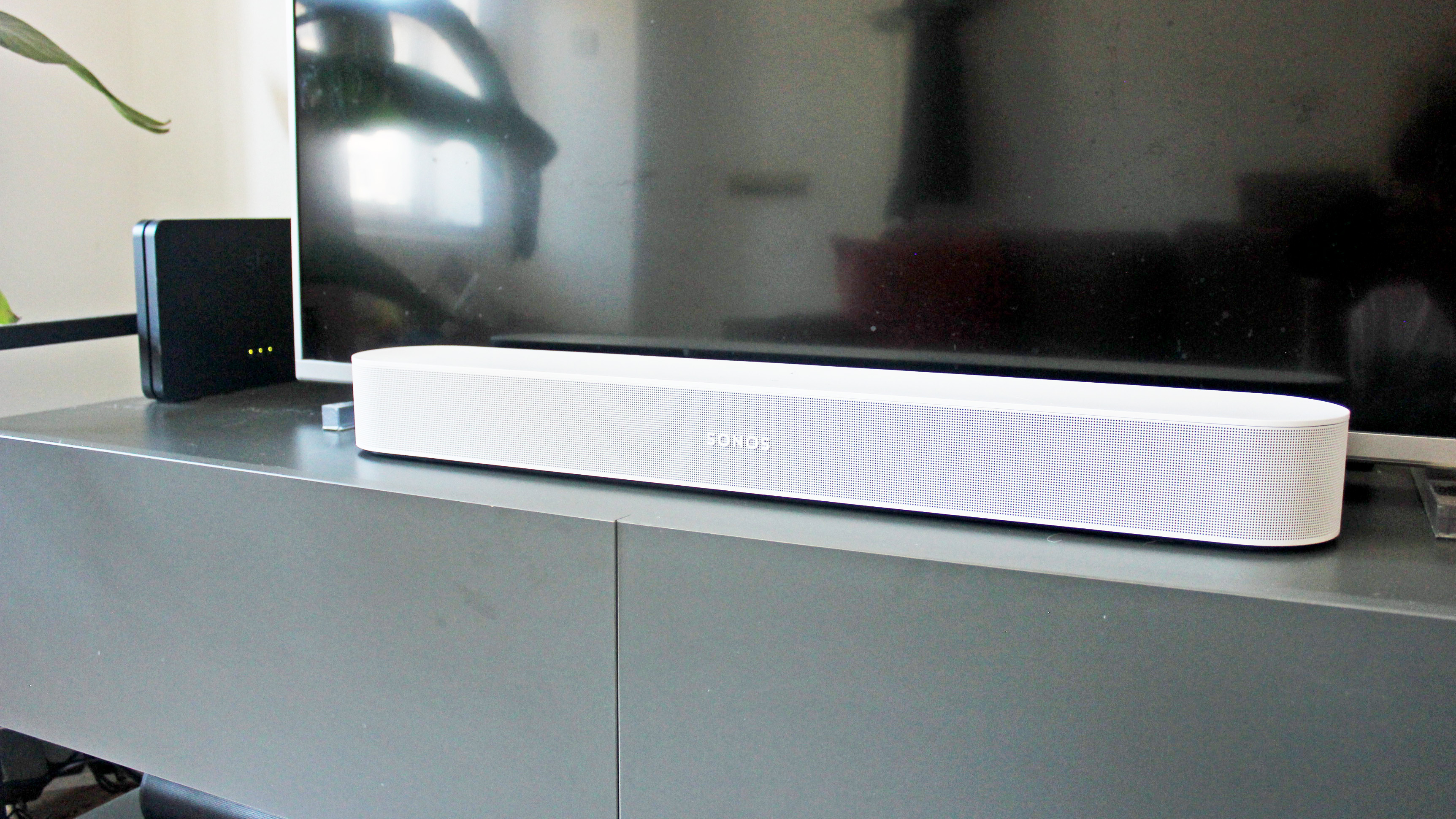 the sonos beam gen 2 soundbar on a tv cabinet