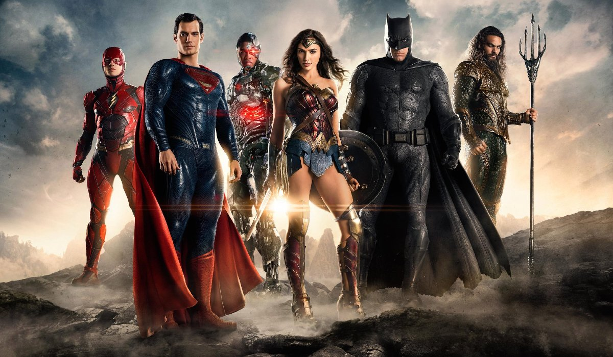 Justice League the entire lineup stands on a hill