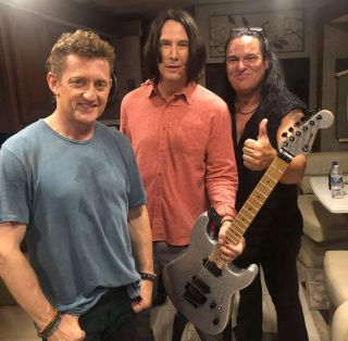 Alex Winter, Keanu Reeves and Andrew Autin pose with custom Charvel San Dimas Pro Mod electric guitar