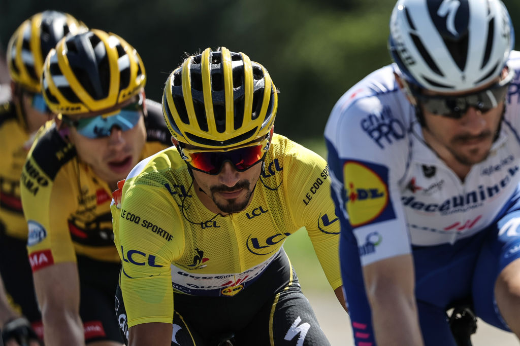 Team Deceuninck rider Frances Julian Alaphilippe C wearing the overall leaders yellow jersey rides in the pack during the 4th stage of the 107th edition of the Tour de France cycling race 157 km between Sisteron and OrcieresMerlette on September 1 2020 Photo by KENZO TRIBOUILLARD AFP Photo by KENZO TRIBOUILLARDAFP via Getty Images