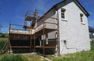 External wall insulation added to old house