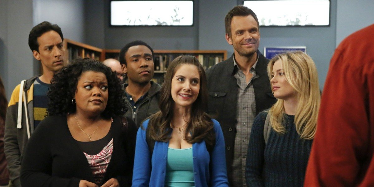 The cast of Community in their library in the show.