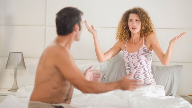 couple arguing in bed for story on how brexit rows lead to people sleeping separately
