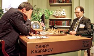 World Chess champion Garry Kasparov (left) ponders a chess move during the sixth and final game of his match with IBM's Deep Blue computer on May 11, 1997.