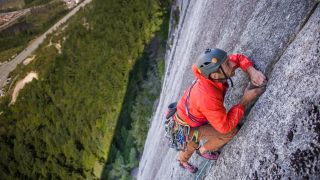 what is trad climbing: climber on rock wall