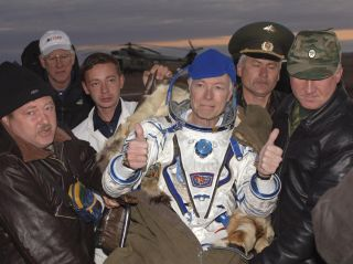 Space tourist Greg Olsen gives two thumb's up after returning to Earth from the International Space Station on a Soyuz spacecraft in October 2005. He returned home with the Expedition 11 crew.