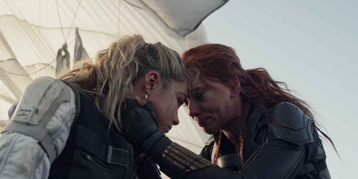 Florence Pugh and Scarlett Johansson put their foreheads together in Black Widow