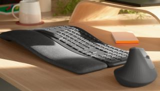 Ergonimic keyboard and mouse by Logitech on a desk