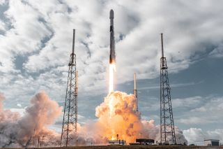 A SpaceX Falcon 9 rocket launches 143 small satellites, including 48 of Earth-imaging company Planet's SuperDove cubesats, into orbit from Cape Canaveral Space Force Station in Florida on Jan. 24, 2021, on the Transporter-1 rideshare mission. Planet and SpaceX recently signed a deal for more such launches through 2025.