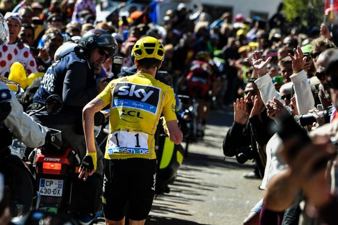 Chris Froome runs for the line during stage 12 of the Tour de France