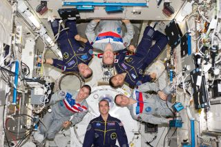The Expedition 38 crew of the International Space Station poses for an in-flight crew portrait in the Kibo laboratory of the International Space Station on Feb. 22, 2014.