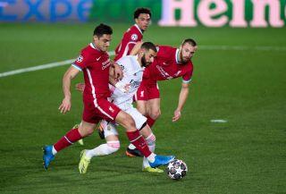 Karim Benzema of Real Madrid competes for the ball with Ozan Kabak of Liverpool