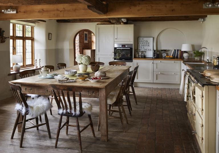 wooden dining area in kitchen in brick-and-flint house