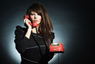A sexy woman on the phone.