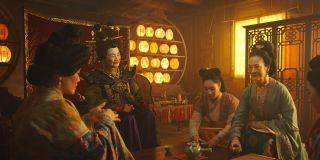 Mulan setting up tea for a ceremony