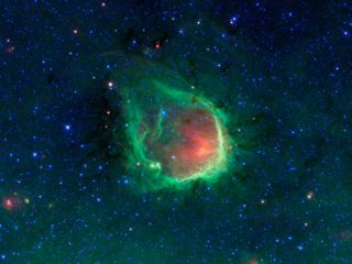 This glowing emerald nebula seen by NASA's Spitzer Space Telescope is reminiscent of the glowing ring wielded by the superhero Green Lantern.