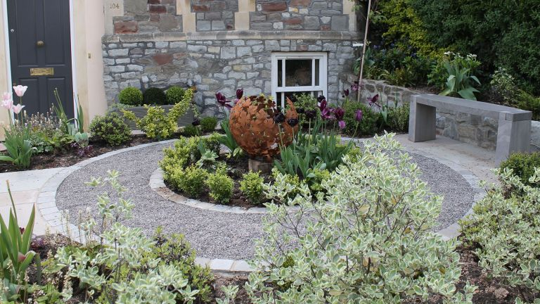small front garden ideas: garden designed by Outerspace Creative Landscaping with round flowerbed and sculpture