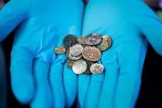 An excavation at Reynard's Kitchen Cave in the UK unearthed 26 coins from the Iron Age and Roman period.