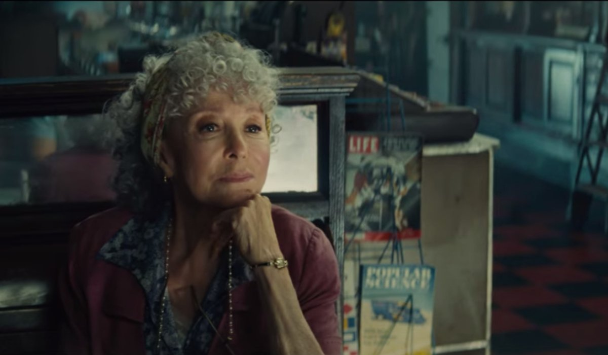 Rita Moreno sits at her counter in West Side Story.