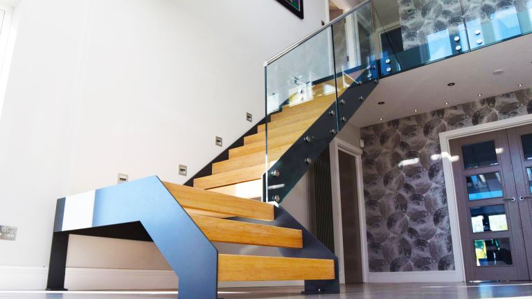 How to design a staircase: Model 500 staircase with oak treads and steel stringers from Complete Stair Systems