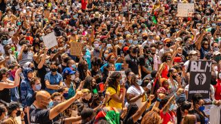 Large crowds protest police brutality and the killing of George Floyd by police. The Black Lives Matter protest, seen here on June 19, 2020, in downtown Chicago, is just one of thousands across the U.S. and globe.