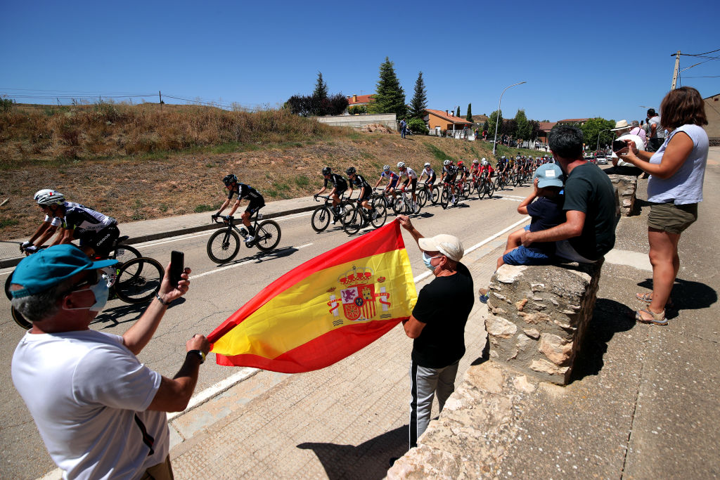 MOLINA DE ARAGON SPAIN AUGUST 17 A general view of Fabio Aru of Italy and Team Qhubeka Nexthash Thymen Arensman of Netherlands Michael Storer of Australia and Team DSM and the peloton while fans cheer during the 76th Tour of Spain 2021 Stage 4 a 1639km stage from El Burgo de Osma to Molina de Aragn 1134m lavuelta LaVuelta21 on August 17 2021 in Molina de Aragn Spain Photo by Gonzalo Arroyo MorenoGetty Images