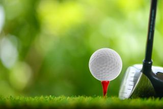 Take part in our new golf survey to win prizes: close-up image of golf ball on red tee
