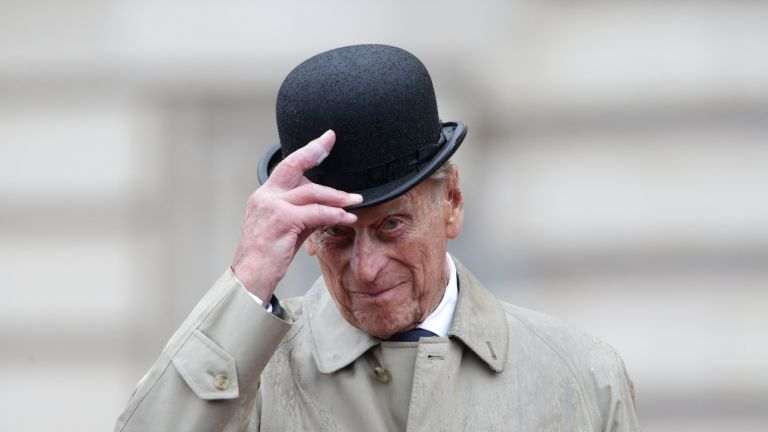 Prince Philip, Duke of Edinburgh raises his hat in his role as Captain General, Royal Marines, makes his final individual public engagement as he attends a parade to mark the finale of the 1664 Global Challenge, on the Buckingham Palace Forecourt on August 2, 2017 in London, England