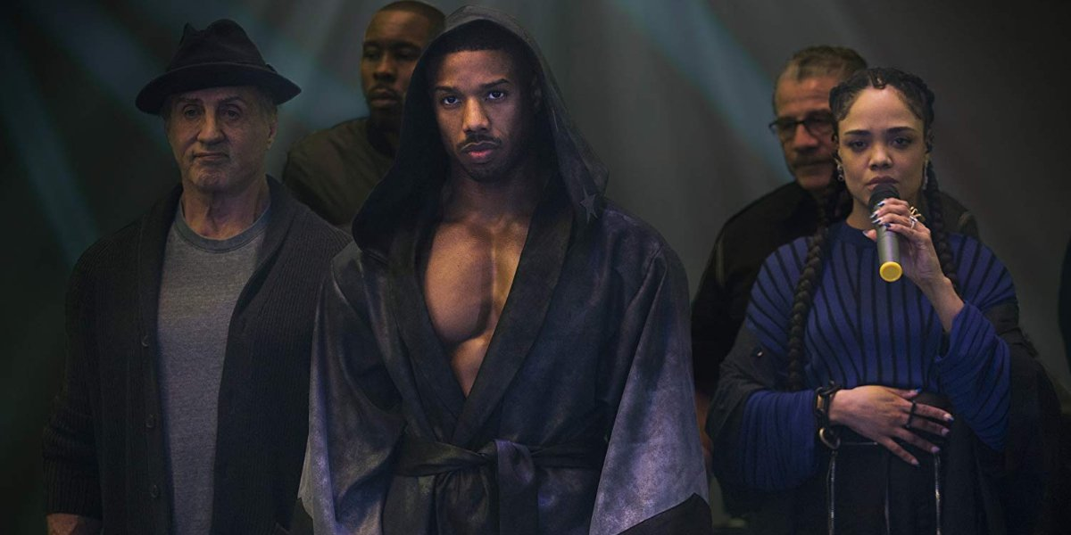Creed II Rocky, Adonis, and Bianca walk into the ring