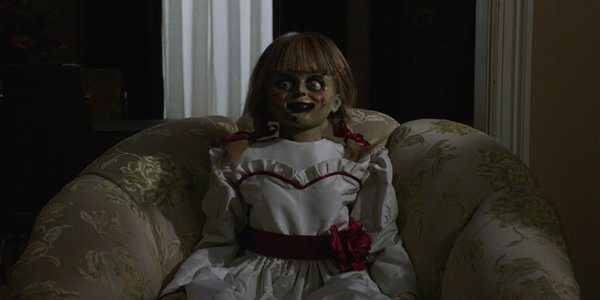 Annabelle sitting on a chair in Annabelle Comes Home