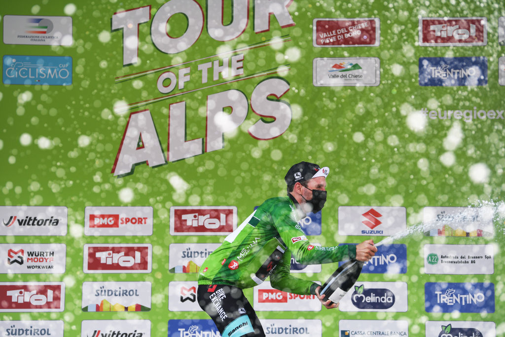 PIEVEDIBONO ITALY APRIL 22 Podium Simon Yates of United Kingdom and Team BikeExchange green leader jersey celebrates during the 44th Tour of the Alps 2021 Stage 4 a 1686 to stage from Naturns to Valle del Chiese Pieve di Bono Mask Covid safety measures Champagne TourofTheAlps TouroftheAlps on April 22 2021 in Pieve di Bono Italy Photo by Tim de WaeleGetty Images