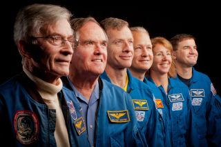 The current and former astronauts who formed the crews of STS-1, the first space shuttle mission, and STS-135, the final shuttle mission, pose for a group photo at the Johnson Space Center in Houston on Nov. 2, 2011.