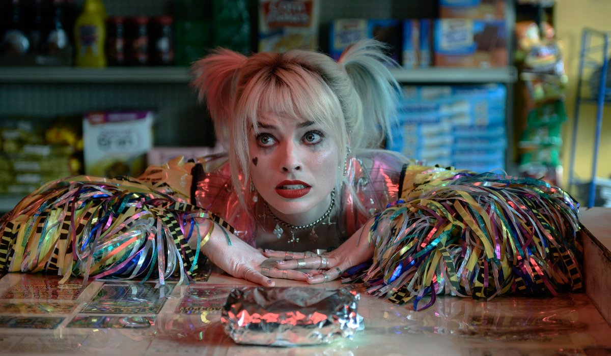 Birds of Prey: Harley Quinn Margot Robbie sits dismayed in front of her egg sandwich
