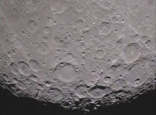 One of NASA's twin Grail spacecraft has returned its first unique picture of the far side of the moon, an image that shows shadowed craters at the moon's south pole.