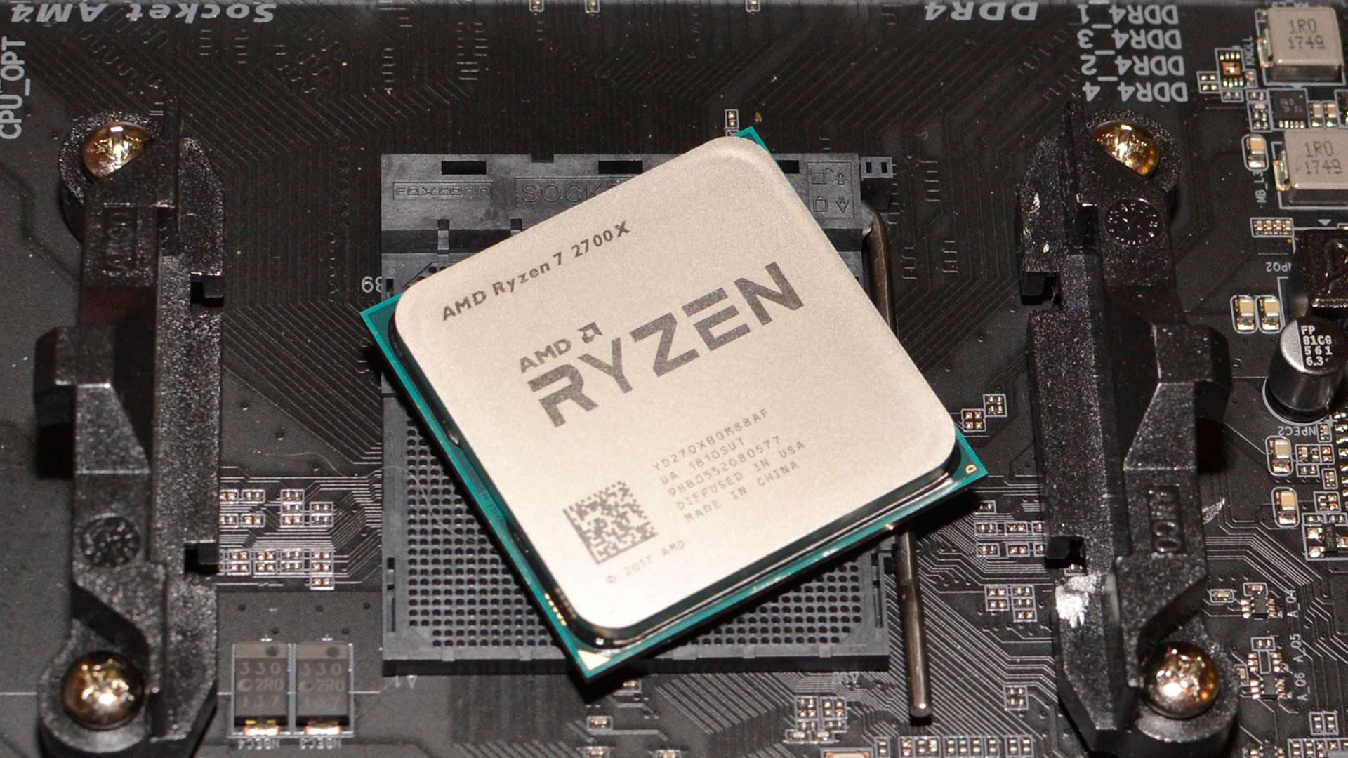 AMD Ryzen CPU sitting atop an AM4 motherboard socket