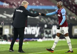 West Ham United manager David Moyes (left) and Angelo Ogbonna celebrate victory after the final whistle during the Premier League match at the London Stadium, London.