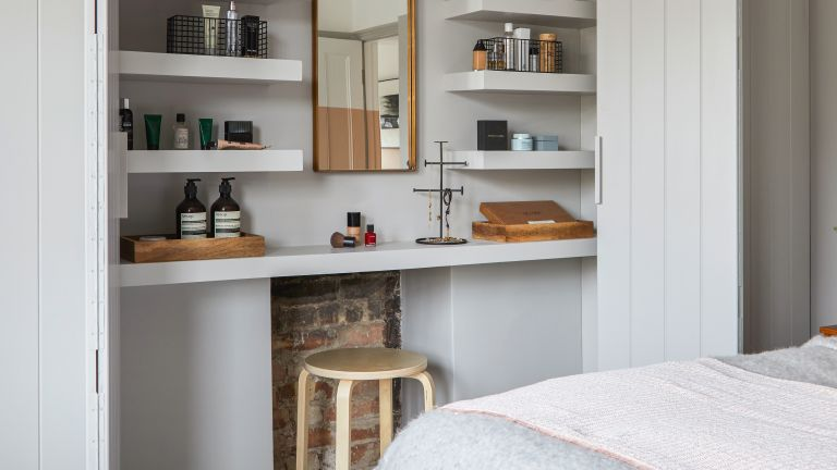 small built in closet with dressing table