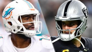 Jacoby Brissett #14 of the Miami Dolphins and Quarterback Derek Carr #4 of the Las Vegas Raiders