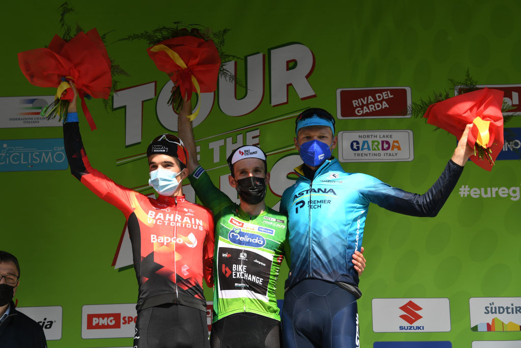 RIVA DEL GARDA ITALY APRIL 23 Pello Bilbao Lpez of Spain and Team Bahrain Victorious Simon Yates of United Kingdom and Team BikeExchange Green Leader Jersey Aleksander Vlasov of Russia and Team Astana Premier Tech celebrate at final podium during the 44th Tour of the Alps 2021 Stage 5 a 1209km stage from Valle del Chiese Idroland to Riva del Garda Mask Covid Safety Measures TourofTheAlps TouroftheAlps on April 23 2021 in Riva del Garda Italy Photo by Tim de WaeleGetty Images