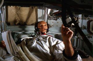 Apollo 11 command module pilot Michael Collins trains aboard a spacecraft simulator in preparation for the 1969 mission.